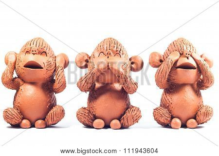 Close-up Monkey Clay Dolls Isolated On White Background