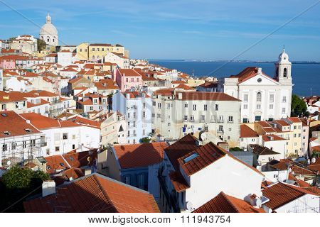 Alfama downtown, left Monastery os S. Vicente de Fora is located to the right Santo Estevao Church, Lisbon, Portugal.