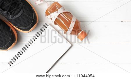 Running Shoes,orange Juice,measuring Tape And Notepad