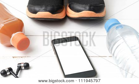 Running Shoes,orange Juice,drinking Water And Phone