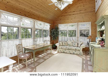 Sun room in luxury home with skylight