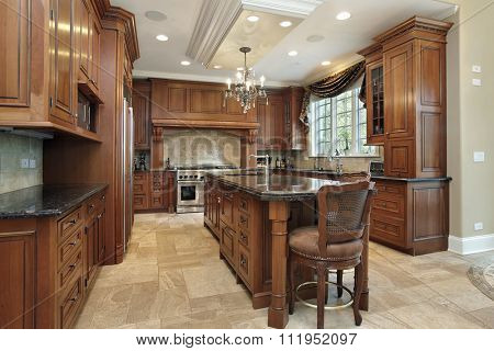 Kitchen in luxury home with large granite island