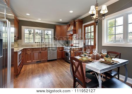Kitchen in suburban home with cherry wood cabinetry