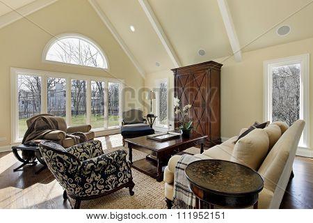 Family room in luxury home with curved window