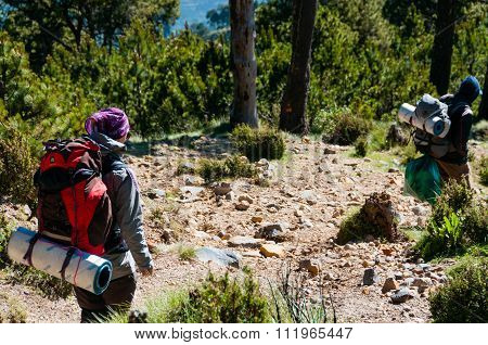 Girl and man Hikers with backpacks Trecking Down The Mountain Tajamulco