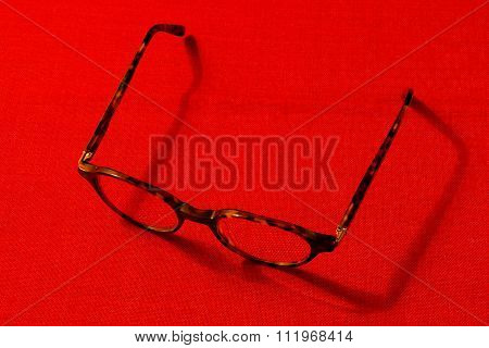 Glasses On A Red Background