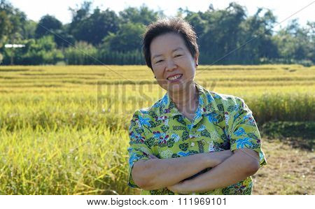 Asian Woman In Bright Shirt At Her Sme Farmland. Abstract Own Agricultural Business.