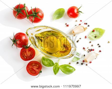 View Of Above Of Olive Oil With Fresh Basil Leaves And Tomatoes