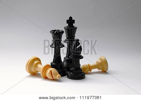 chess battle - plastic chess pieces - king, queen, bishop, pawn