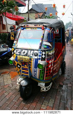 TukTuk Taxi is driving on the central part of Jakarta, Indonesia