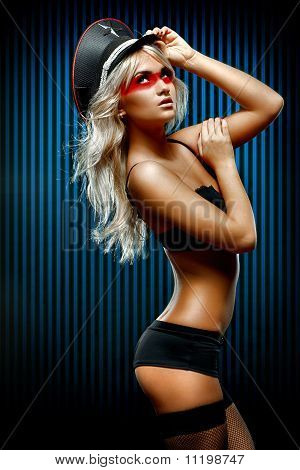 Young Sexy Woman In Front Of Wall Of Blue Stripes