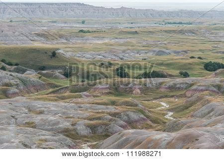 Badlands With Creek Water
