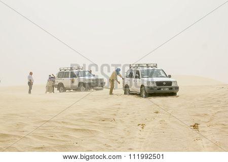 The Caravan Of Suvs Stuck In The Sahara Desert In A Sandstorm.tunisia.