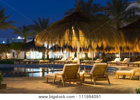 Straw Umbrellas And Sunbeds By The Pool In Sharm El Sheikh