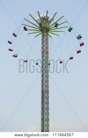 United Arab Emirates, Dubai, 04/11/2015, A sky ride at Global Village theme park,spinning around.