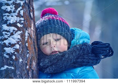 A Small Child In The Winter Forest
