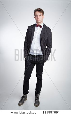 Elegant young man in a suit