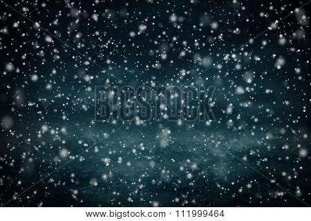 Dense snow flurries before evening sky