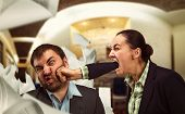 Businesswoman shouts at young businessman and beats him  poster