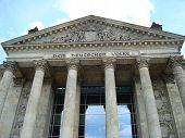 Inscription at entrance of Reichstag building in Berlin, Germany, Europe is Dem Deutchen Volke in German meaning To The German People in English poster