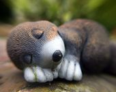 a macro of a mole in a garden...plastic one! poster