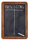 pros and cons, blank list of pro and con arguments - white chalk handwriting on a vintage slate blackboard poster