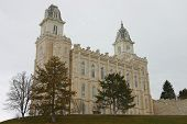 the manti temple located in manti utah sits upon a high knoll overlooking the small town of manti. poster