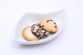 Delicious Cookies And Biscuits On White Plate