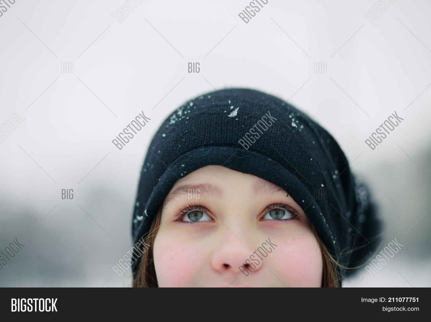 652cd4be75d66 girl s eyes are looking up. Girl in a black beret. A child with beautiful  green eyes against the background of a winter landscape.