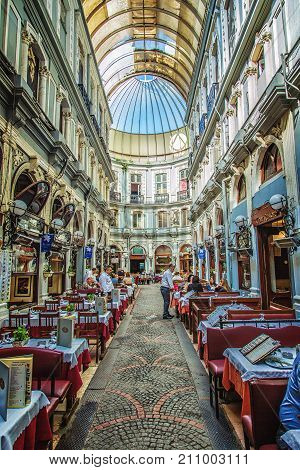 ISTANBUL TURKEY: Interior shot from Cicek Pasaji Flower Passage a famous historic passage with historic cafes winehouses and restaurants situated on Istiklal Avenue Beyoglu on October 6 2017