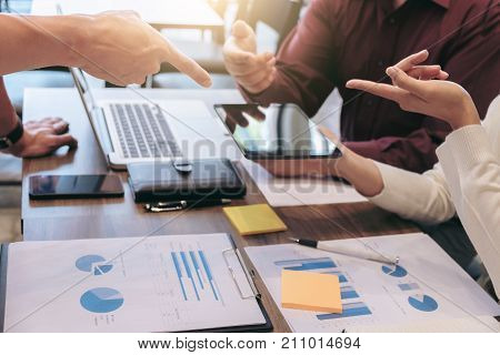 Startup business people group meeting Young creative coworkers team working and discussing new plan project in office entrepreneurs brainstorming Teamwork analyze plans professional investor.