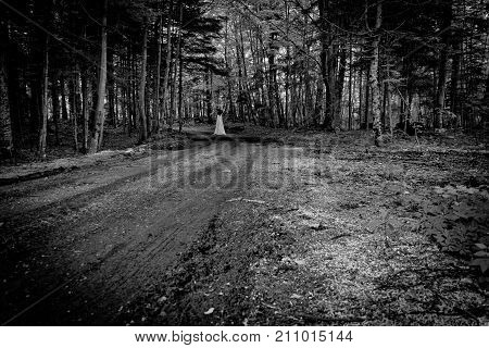 Horror scene of a scary woman in the spooky forest