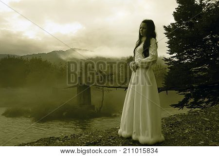 Mysterious Woman in White Dress in the Foggy Mountains