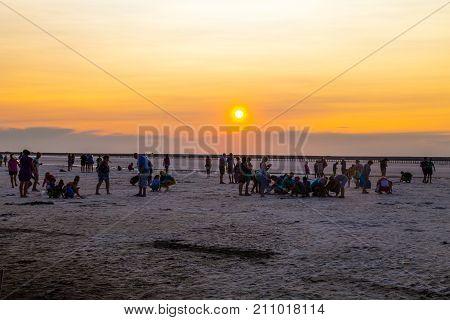 People Gathering Salt Of Pink Salty Siwash Lake