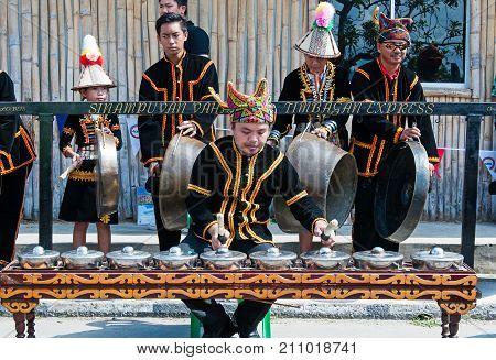 Kota Kinabalu, Malaysia - May 31, 2016: Group Of People Playing Gong, A Musical Instrument During Sa