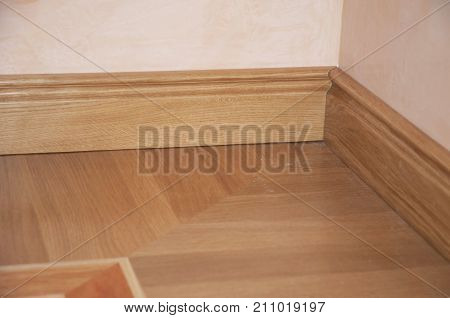 Skirting Board & Architrave. Wood Flooring. Skirting Board Oak Wooden Floor . Flooring with Wooden Batten Repair.
