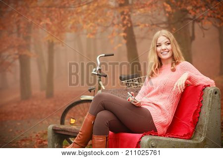 Girl Listening To Music Mp3 Relaxing In Autumn Park
