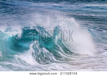 turquoise wave is illuminated from the middle , surfing, seas and oceans