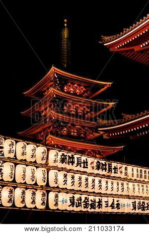 TOKYO, JAPAN - OCTOBER 10: Senso-ji Buddhist temple Pagoda with japanese traditional lanterns in Asakusa district at night OCTOBER 10, 2017 in Tokyo, Japan