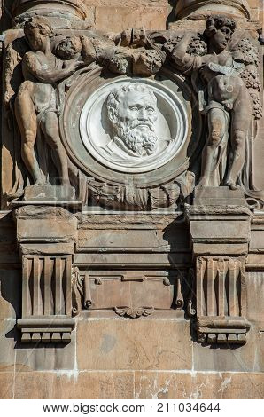 Italy Tuscany Florence - October 23, 2017: Michelangelo Buonarroti by Olinto Calastri (1920) portrait medallion on the Central National Library facade.