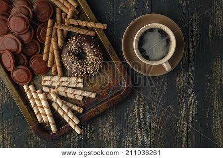 Chocolates Background. Chocolate. Cup Of Hot Chocolate, Lemon, Nuts And Assortment Of Fine Chocolate