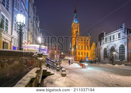 GDANSK, POLAND - FEBRUARY 8, 2017: Old town of Gdansk at snowy night, Poland. Gdansk is the historical capital of Polish Pomerania with medieval old town architecture.