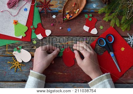 Making Of Handmade Christmas Toys From Felt With Your Own Hands. Children's Diy Concept. Making Xmas