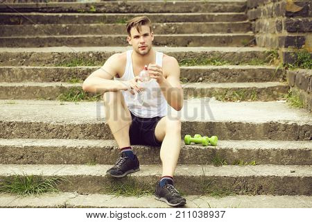 Sportsman With Serious Face Sitting On Concrete Stairs