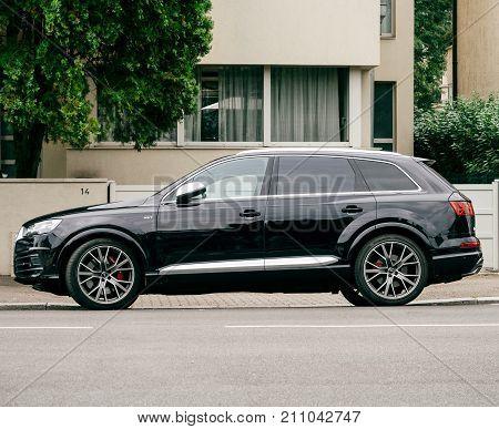 PARIS FRANCE - JUN 25 2017: New black luxury allroad quattro Audi V6 vehicle parked in an upper-class neighbourhood in Strasbourg France