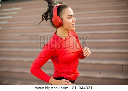 Active Young Beautiful Woman Running In Urban Enviroment