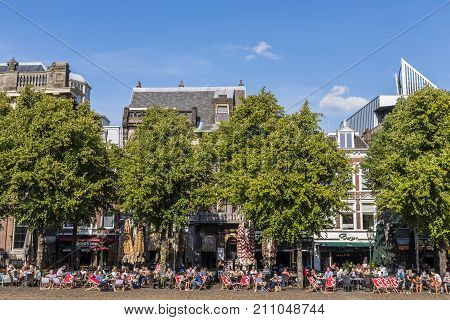 The Hague The Netherlands - August 6 2017: Restaurants and tourists at the terraces at the Plein in The Hague on a summers day.