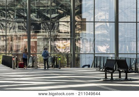 The Hague The Netherlands - August 6 2017: Central Train Station The Hague with travellers at the escalator in the great glass hall.