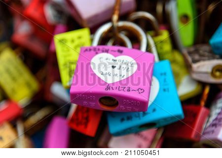 A Padlock Attached To A Fence Of The Seoul Tower With A Promise Of Eternal Love.