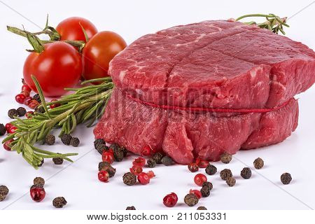 Delicious portion of fresh filet mignon with aromatic herbs
